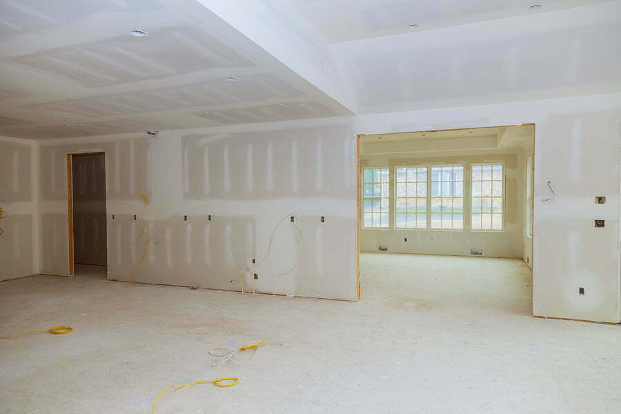 home renovation in room full of under construction site interior drywall